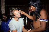 Amazon, Brazil. Sting with Chief Raoni of the Megranoti-Kayapo and Olympio Serra; Nov 1990.