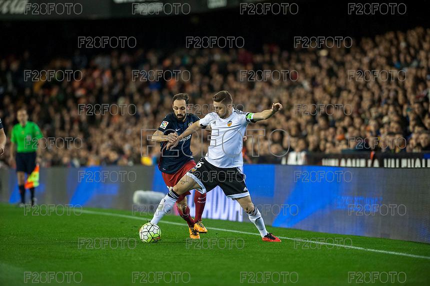 VALENCIA, SPAIN - MARCH 6: Juanfran, Cheryshev during BBVA League match between Valencia C.F. and Athletico de Madrid at Mestalla Stadium on March 6, 2015 in Valencia, Spain