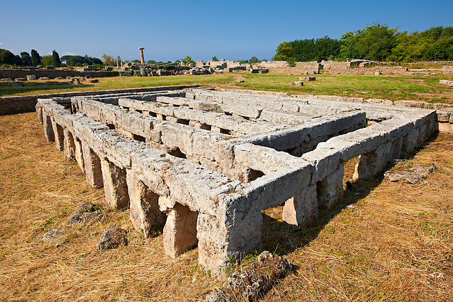 Base of a Roman Temple ( 200 BC) in  Paestum dedicated to the Capitoline Triad, Jupiter, Juno and Minerva, in the Roman Forum. Paestum archaeological site, Italy.