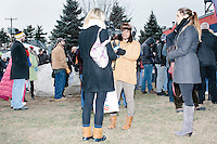 A Boston Herald reporter interviews a woman in the crowd before Texas senator and Republican presidential candidate Ted Cruz speaks at a Second Amendment Rally outside Granite State Indoor Range in Hudson, New Hampshire.