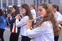 high school students girls playing flutes
