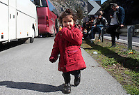 Pictured: A young girl walks on the hard shoulder Thursday 25 February 2016<br /> Re: Hundreds of migrants, including families with young children, that were stranded at Tempe in central Greece, were forced to walk on foot on the motorway to reach Idomen, about 168 kilometres away, in the northern part of the country, at the Greek FYRO Macedonian border. Local police were at first escorting them, then made sure that they were safely transported on coaches.