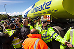 © Joel Goodman - 07973 332324 . 08/05/2011 .  Ellesmere Port, UK . Police separate protesters from fuel lorries entering and leaving Stanlow Oil Refinery . An attempted blockade of Stanlow Oil Refinery at Ellesmere Port , Cheshire , in protest at the price of fuel . Organiser Ian Charlesworth says that a 24 pence discount off the price of a litre of petrol is required to bring the UK in line with average European pricing and to keep British businesses competitive . Photo credit : Joel Goodman