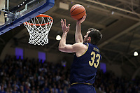 DUKE, NC - FEBRUARY 15: John Mooney #33 of the University of Notre Dame shoots a layup during a game between Notre Dame and Duke at Cameron Indoor Stadium on February 15, 2020 in Duke, North Carolina.