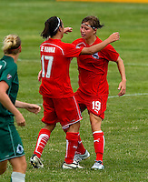 Washington Freedom midfielder Rebecca Moros (19) is congratulated by Freedom forward Lisa De Vanna (17)  after scoring a goal against the St. Louis Athletica during a WPS match at Anheuser-Busch Soccer Park, in Fenton, MO, June 20 2009. Washington  won the match 1-0.