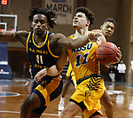 SIOUX FALLS, SD - MARCH 7: Jarius Cook #11 of the North Dakota State Bison drives on Franck Kamgain #11 of the UMKC Kangaroos during the Summit League Basketball Tournament at the Sanford Pentagon in Sioux Falls, SD. (Photo by Richard Carlson/Inertia)