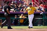 Erie SeaWolves manager Arnie Beyeler (22) questions a call with umpire Gabriel Alfonzo during a game against the Harrisburg Senators on September 5, 2021 at UPMC Park in Erie, Pennsylvania.  (Mike Janes/Four Seam Images)