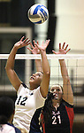 Nevada setter Tatiana Santiago and Seattle University defender Kaytlyn Dill compete in an NCAA women's college volleyball match in Reno, Nev., on Thursday, Oct. 20, 2011. Nevada won 3-0..Photo by Cathleen Allison