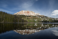 The stunning reflections in Bear Tooth Lake, the Rockies.