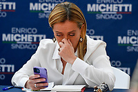 The leader of Fratelli d Italia right party Giorgia Meloni looks at her smartphone as she attends an electoral campaign press conference for the mayoral election in Spinaceto, a peripheral neighborhood in the west of Rome on October 1st 2021. Photo Andrea Staccioli Insidefoto