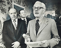 1977 FILE PHOTO - ARCHIVES -<br /> <br /> Quebec Cabinet Minister Claude Morin, (left), listens as former federal finance minister Walter Gordon makes plea for national unity at opening of expanded Quebec government offices in Commerce Court. Morin promised to deliver Gordon's message to Quebec Premier Rene Levesque, but indicated he had not changed his goal of independent Quebec, in economic association with rest of Canada<br /> 1977<br /> <br /> PHOTO : Boris Spremo - Toronto Star Archives - AQP