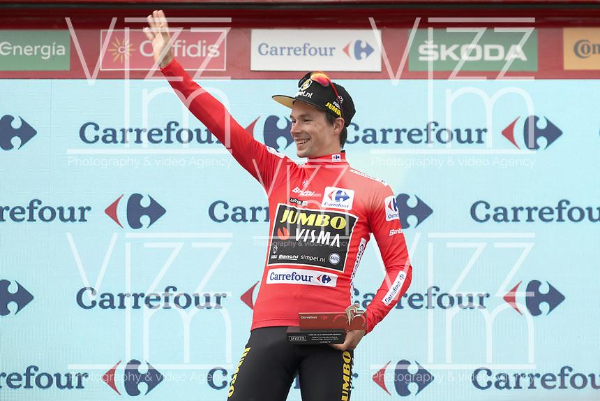 ESPAÑA, 12-09-2019: Primoz Roglic (SLO - YUMBO VISMA) celebra con el maillot rojo líder después de la etapa 18, hoy, 12 de septiembre de 2019, que se corrió entre Comunidad de Madrid. Colmenar Viejo y Becerril de la Sierra con una distancia de 177,5 km como parte de La Vuelta a España 2019 que se disputa entre el 24/08 y el 15/09/2019 en territorio español. / Primoz Roglic (SLO - YUMBO VISMA) celebrates with the red leader jersey after the stage 18 today, September 12, 2019, from Comunidad de Madrid. Colmenar Viejo to Becerril de la Sierra with a distance of 177,5 km as part of Tour of Spain 2019 which takes place between 08/24 and 09/15/2019 in Spain.  Photo: VizzorImage / Luis Angel Gomez / ASO<br /> VizzorImage PROVIDES THE ACCESS TO THIS PHOTOGRAPH ONLY AS A PRESS AND EDITORIAL SERVICE AND NOT IS THE OWNER OF COPYRIGHT; ANOTHER USE HAVE ADDITIONAL PERMITS AND IS  REPONSABILITY OF THE END USER