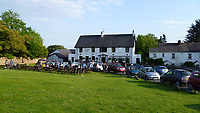 Pictured: The King Arthur restaurant, in Reynoldston, Wales, UK.<br /> Re: A restaurant has stuck pictures of Wales' First Minister Mark Drakeford on its pumps at the bar and on a dart board, after recent changes to Covid-19 regulations, banned the serving of alcohol and all hospitality businesses closing at 6pm.<br /> The pictures at the King Arthur restaurant in Reynoldston in the Gower Peninsula, show the Welsh politician sipping water from a glass wearing a Santa hat which has been superimposed.