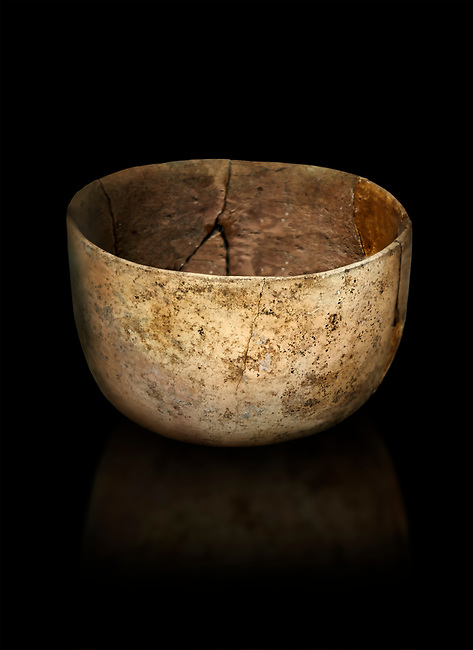 Neolithic terracotta bowl. Catalhoyuk collection, Konya Archaeological Museum, Turkey. Against a black background