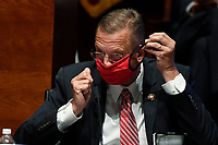 United States Representative Doug Collins (Republican of Georgia), puts on his mask during a House Judiciary Committee hearing on Capitol Hill in Washington, Wednesday, June 24, 2020, on oversight of the Justice Department and a probe into the politicization of the department under Attorney General William Barr.<br /> Credit: Susan Walsh / Pool via CNP/AdMedia