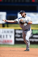Mobile BayBears third baseman Garrett Weber (4) throws to first during a game against the Huntsville Stars on April 23, 2014 at Joe Davis Stadium in Huntsville, Tennessee.  Huntsville defeated Mobile 4-1.  (Mike Janes/Four Seam Images)