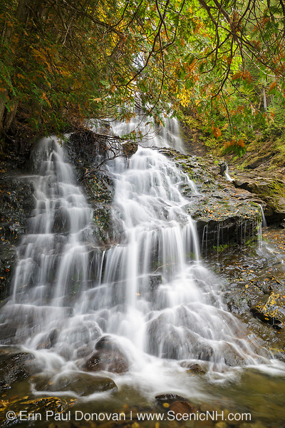 Beaver Brook Falls Natural Area in Colebrook, New Hampshire during the autumn months. This scenic roadside waterfall is along Route 145 on Beaver Brook.