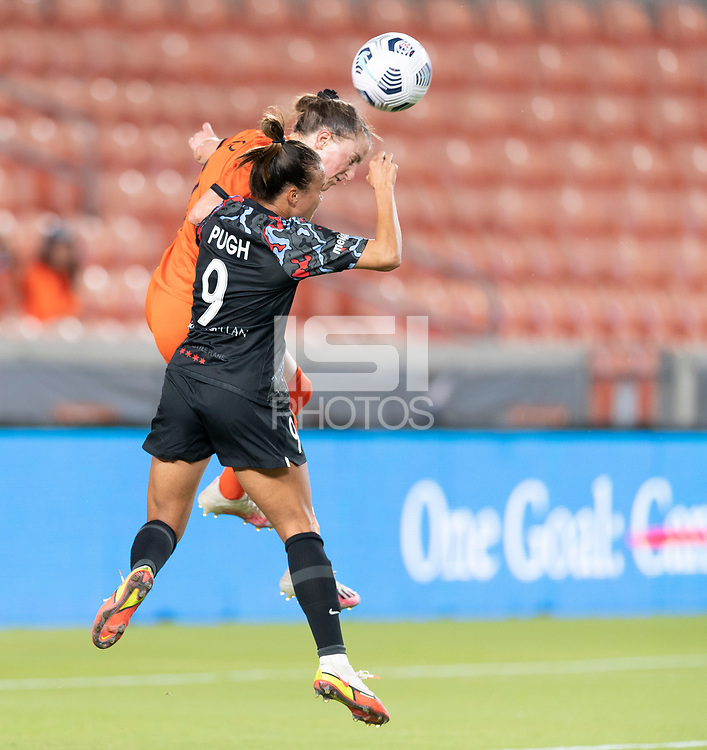 HOUSTON, TX - SEPTEMBER 10: Mallory Pugh #9 of the Chicago Red Stars and Haley Hanson #9 of the Houston Dash go up for a header during a game between Chicago Red Stars and Houston Dash at BBVA Stadium on September 10, 2021 in Houston, Texas.