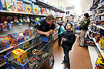 Matt Cooper, with Carson City Fire, shops with Lucas, 11, at the 15th annual Holiday with a Hero program at Walmart in Carson City, on Wednesday, Dec. 19, 2018. The program, which pairs local heroes with more than 200 K-8th graders, provides a $100 Christmas shopping spree at Walmart.  <br /> Photo by Cathleen Allison/Nevada Momentum