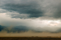Blowing sand and storm clouds in the Badwater Basin, near Furnace Creek, Death Valley National Park, California