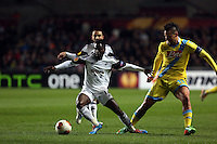 Swansea, UK. Thursday 20 February 2014<br /> Pictured L-R: Nathan Dyer of Swansea gets the ball away from Marek Hamsik of Napoli<br /> Re: UEFA Europa League, Swansea City FC v SSC Napoli at the Liberty Stadium, south Wales, UK