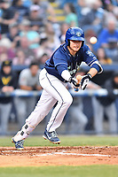 Asheville Tourists third baseman Kyle Datres (3) attempts to bunt during a game against the West Virginia Power at McCormick Field on April 18, 2019 in Asheville, North Carolina. The Power defeated the Tourists 12-7. (Tony Farlow/Four Seam Images)