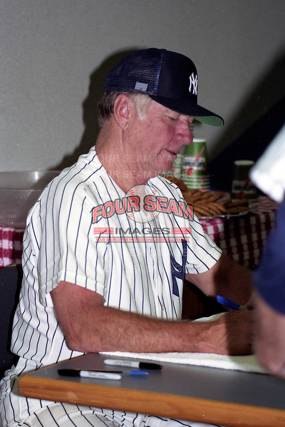 Mickey Mantle signs autographs during the Mickey Mantle-Whitey Ford Fantasy Camp circa November 1990 at Fort Lauderdale Stadium in Ft. Lauderdale, Florida.  (MJA/Four Seam Images)