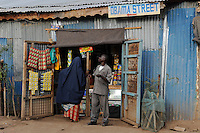 KENYA Turkana Region, UNHCR refugee camp Kakuma, where permanent 80.000 refugees from Somalia, Ethiopia, South Sudan are living, shop in Obama Street/ KENIA UNHCR Fluechtlingslager Kakuma in der Turkana Region , hier leben ca. 80.000 Fluechtlinge aus Somalia Sudan Aethiopien, Laden in der der Obama Street