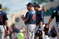 Atlanta Braves manager Brian Snitker (43) makes a pitching change as catcher Alex Jackson (70) looks on during a Grapefruit League Spring Training game against the Detroit Tigers on March 2, 2019 at Publix Field at Joker Marchant Stadium in Lakeland, Florida.  Tigers defeated the Braves 7-4.  (Mike Janes/Four Seam Images)