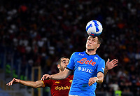 Calcio, Serie A: AS Roma vs SSC Napoli, Olympic stadium, October 24, 2021.<br /> Napoli's Piotr Zielinski (R) in action with Roma's Henrikh Mkhitaryan (L) during the Italian Serie A football match between Roma and Napoli at Rome's Olympic stadium, on , October 24, 2021. <br /> UPDATE IMAGES PRESS/Isabella Bonotto