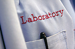 Laboratory written over lab coat pocket