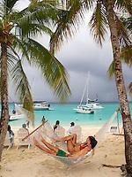 Couple in a hammock at Sandcastle<br /> White Bay<br /> Jost Van Dyke