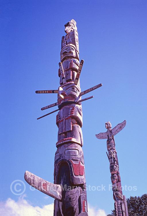 Kwakwaka'wakw (Kwakiutl) Memorial Totem Poles, on Namgis Burial Grounds, Alert Bay, Cormorant Island, BC, British Columbia, Canada - First Totem Pole: Kolus sits atop Cedar Man, above Sun Figure and Killer Whale