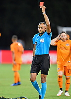 LAKE BUENA VISTA, FL - JULY 18: Referee Ismail Elfath shows a red card to a player during a game between Houston Dynamo and Portland Timbers at ESPN Wide World of Sports on July 18, 2020 in Lake Buena Vista, Florida.