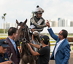 HALLANDALE BEACH, FL - March 31: Owners Rick Pitino and Roddy Valente congratulate jockey Luis Saez on his win aboard Coach Rocks for Trainer Dale Romans after the Gulfstream Park Oaks at Gulfstream Park on March 31, 2018 in Hallandale Beach, FL. (Photo by Carson Dennis/Eclipse Sportswire/Getty Images.)