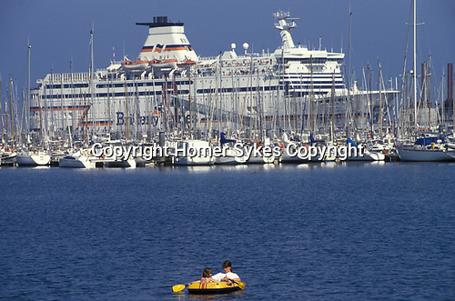 Brittany Ferries boats and yachts in harbour St Malo beach with people on holiday France Europe 1990s