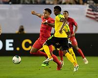 NASHVILLE, TN - JULY 3: Weston Mckennie #8 and Devon Williams #22 go after the ball during a game between Jamaica and USMNT at Nissan Stadium on July 3, 2019 in Nashville, Tennessee.