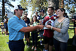 NFL quarterback Aaron Rodgers signs autographs during a practice round in the American Century Celeb-Am Tournament at Edgewood Tahoe in Stateline, Nev., on Thursday, July 18, 2013.<br /> Photo by Cathleen Allison