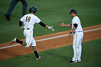 Bradenton Marauders designated hitter Jordan George (10) is congratulated as he rounds the bases after hitting a home run in the bottom of the fourth inning during the second game of a doubleheader against the Tampa Yankees on June 14, 2017 at LECOM Park in Bradenton, Florida.  Tampa defeated Bradenton 5-1.  (Mike Janes/Four Seam Images)
