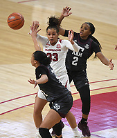 Arkansas' Chelsea Dungee passes under pressure from Texas A&M's N'dea Jones and Aaliyah Wilson Sunday Jan. 10, 2021 at Bud Walton Arena in Fayetteville. Arkansas lost 74-73. Visit nwaonline.com/210111Daily/ and nwadg.com/photos. (NWA Democrat-Gazette/J.T. Wampler)