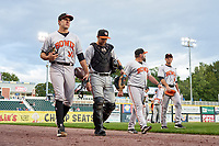 Bowie Baysox pitcher Grayson Rodriguez (30), catcher Cody Roberts (34), pitching coach Justin Ramsey (22), and coach Jeff Kunkel (7) walk to the dugout before a game against the Harrisburg Senators on September 9, 2021 at FNB Field in Harrisburg, Pennsylvania.  (Mike Janes/Four Seam Images)