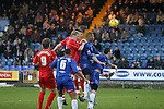 Stockport County 2 Rushden & Diamonds 2, 22/01/2006. Edgeley Park, League Two. Stockport County versus Rushden & Diamonds, Coca-Cola Football League Two at Edgeley Park, Stockport. With the teams occupying the bottom two places in the Football league, points were vital in home club's Jim Gannon's first game in charge as manager. The match ended 2-2. Picture shows County (blue) defending a corner in the second half.<br />  Photo by Colin McPherson.