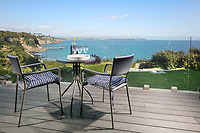 BNPS.co.uk (01202 558833)<br /> Pic: Rohrs&Rowe/BNPS<br /> <br /> Pictured: The garden has a wide patio and a large lawn that gently slopes down towards the cliff with a gate at the bottom giving access onto the coast path.<br /> <br /> An exceptional contemporary clifftop home with panoramic views of not one, but two beaches is on the market for offers over £2m.<br /> <br /> Seascape is a brand new home, completed earlier this year and never lived in, that has a frontline spot next to Porthpean Beach and Duporth Beach.<br /> <br /> The sleek four-bedroom home in the village of Porthpean, Cornwall, has incredible sea views from almost every room, a full width balcony and a gate in the garden straight onto the South West Coast Path.