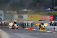 Sep 14, 2019; Mohnton, PA, USA; NHRA top fuel driver Doug Kalitta (left) races alongside Richie Crampton during qualifying for the Reading Nationals at Maple Grove Raceway. Mandatory Credit: Mark J. Rebilas-USA TODAY Sports