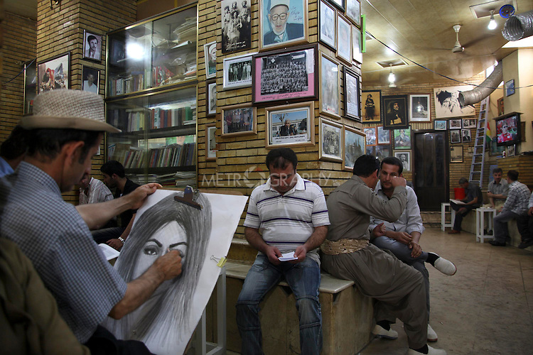 SULAIMANIYAH, IRAQ: Mahmoud draws a portrait in the Shab Cafe...Mahmoud Mohamed Salh, is a portrait artist in the Shab Cafe in Sulaymaniyah. Mahmoud, a former PeshMerga (Iraqi Kurdish guerilla), does not own a house and is not married. He lives in his brother's house on the outskirts of Sulaymaniyah. Mahmoud draws portraits for $4...Photo by Asaad Zwain/Metrography