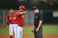 AZL Reds manager Jose Nieves (15) argues a call with umpire Tyler Wall during an Arizona League game against the AZL Athletics Green on July 21, 2019 at the Cincinnati Reds Spring Training Complex in Goodyear, Arizona. The AZL Reds defeated the AZL Athletics Green 8-6. (Zachary Lucy/Four Seam Images)