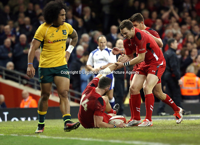 Pictured: Alex Cuthbert of Wales (14) is helped up by team mate George North after scoring a try for his team. Saturday 08 November 2014<br /> Re: Dove Men Series rugby, Wales v Australia at the Millennium Stadium, Cardiff, south Wales, UK.