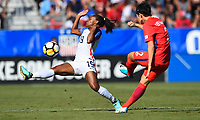 Cary, NC - Sunday October 22, 2017: Crystal Dunn, Lee Eunmi during an International friendly match between the Women's National teams of the United States (USA) and South Korea (KOR) at Sahlen's Stadium at WakeMed Soccer Park.