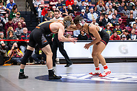 STANFORD, CA - March 7, 2020: Grant Willits of Oregon State University and Real Woods of Stanford during the 2020 Pac-12 Wrestling Championships at Maples Pavilion.
