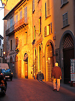 Man walking along Corso Cavour in early morning, Orvieto, Ital